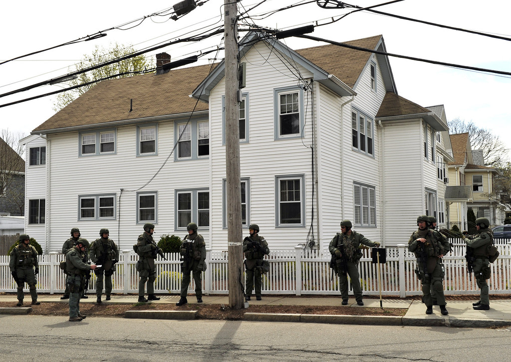Description of . The Cape Cod  Police Department SWAT team search houses for the second of two suspects wanted in the Boston Marathon bombings takes place April 19, 2013 in Watertown, Massachusetts. AFP PHOTO / TIMOTHY  A. CLARY/AFP/Getty Images