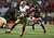 Wide receiver Michael Crabtree #15 of the San Francisco 49ers runs after catching a 33-yard pass in the fourth quarter against the Atlanta Falcons in the NFC Championship game at the Georgia Dome on January 20, 2013 in Atlanta, Georgia.  (Photo by Streeter Lecka/Getty Images)