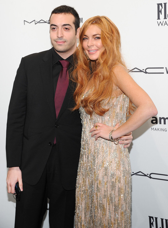 Description of . Producer Mohammed Al Turki and actress Lindsay Lohan attend amfAR's New York gala at Cipriani Wall Street on Wednesday, Feb. 6, 2013 in New York. (Photo by Evan Agostini/Invision/AP)