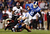 Drew Frey #26 of the Cincinnati Bearcats dives to tackle Conner Vernon #2 of the Duke Blue Devils during their game at Bank of America Stadium on December 27, 2012 in Charlotte, North Carolina.  (Photo by Streeter Lecka/Getty Images)