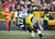 Sam Shields #37 of the Green Bay Packers sacks Jake Locker #10 of the Tennessee Titans at Lambeau Field on December 23, 2012 in Green Bay, Wisconsin.  (Photo by Tom Lynn /Getty Images)