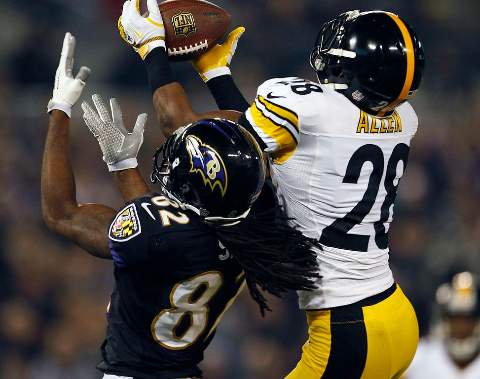 Description of . Pittsburgh Steelers cornerback Cortez Allen (R) breaks up a pass intended for Baltimore Ravens receiver Torrey Smith during the first half of their NFL football game in Baltimore December 2, 2012.  REUTERS/Gary Cameron