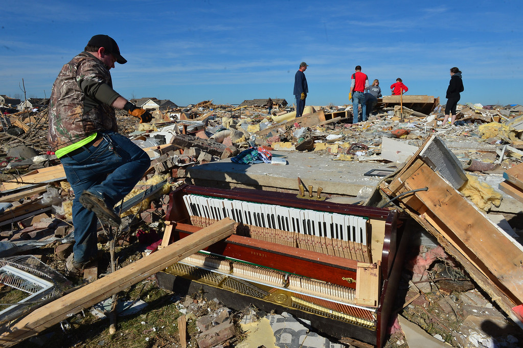 Description of . A piano lays battered as homeowners dig out what they can Tuesday, Nov. 19, 2013, in Washington, Ill., after more than 1,000 homes were devastated by a F4 tornado that passed through Sunday. The twister was the most powerful to hit Illinois since 1885 with wind speeds greater than 200 mph. (AP Photo/Journal Star, Fred Zwicky)