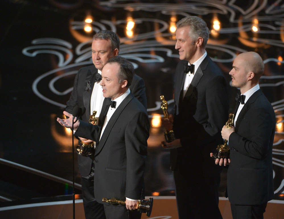 Description of . Neil Corbould,  from left, Tim Webber, David Shirk, and Chris Lawrence accept the award for best visual effects for ìGravityîduring the Oscars at the Dolby Theatre on Sunday, March 2, 2014, in Los Angeles.  (Photo by John Shearer/Invision/AP)