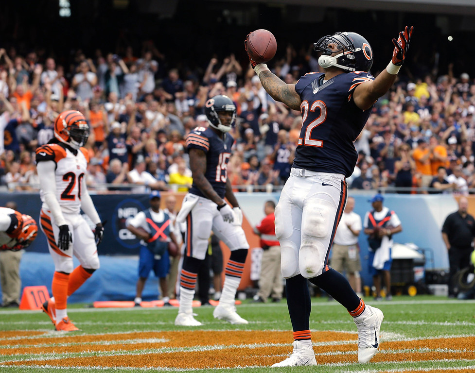 Description of . Chicago Bears running back Matt Forte (22) celebrates after rushing for a touchdown against the Cincinnati Bengals during the second half of an NFL football game, Sunday, Sept. 8, 2013, in Chicago. (AP Photo/Nam Y. Huh)