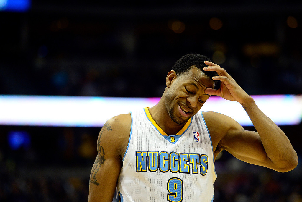 Description of . Denver Nuggets shooting guard Andre Iguodala (9) rubs his head against the Los Angeles Lakers during the first half at the Pepsi Center on Wednesday, December 26, 2012. AAron Ontiveroz, The Denver Post