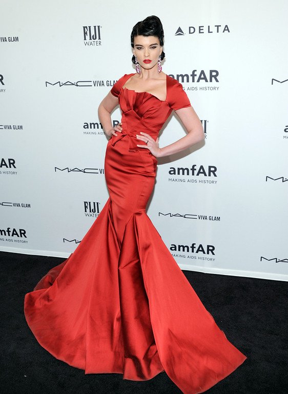 Description of . Model Crystal Renn attends amfAR's New York gala at Cipriani Wall Street on Wednesday, Feb. 6, 2013 in New York. (Photo by Evan Agostini/Invision/AP)