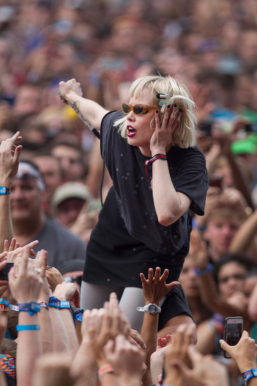 Description of . Alice Glass, vocalist for Canadian electronic band Crystal Castles interacts with fans after jumping off stage during their performance at the Lollapalooza Festival in Chicago, Friday, Aug. 2, 2013. The more than two-decade-old festival opens Friday in Chicago's lakefront Grant Park. (AP Photo/Scott Eisen)
