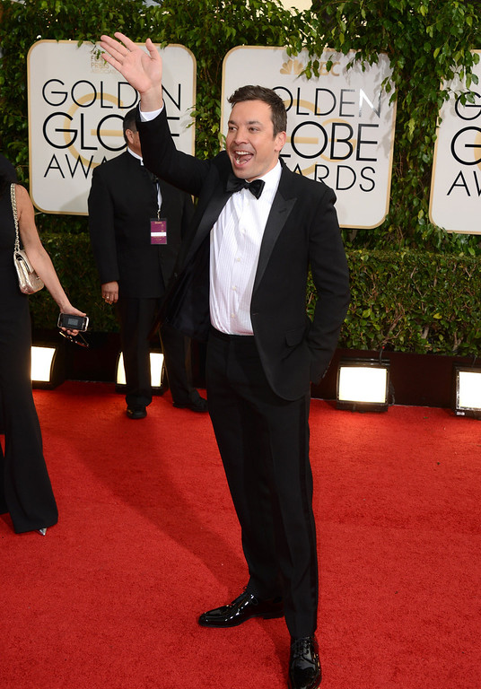 Description of . Jimmy Fallon arrives at the 71st annual Golden Globe Awards at the Beverly Hilton Hotel on Sunday, Jan. 12, 2014, in Beverly Hills, Calif. (Photo by Jordan Strauss/Invision/AP)