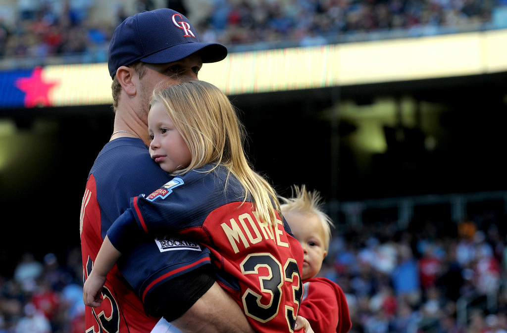 Description of . National League All-Star Justin Morneau holds his daughter and son prior to the start of  the MLB All-Star Home Run Derby at Target Field in Minneapolis on Monday, July 14, 2014.  (Pioneer Press: Sherri LaRose-Chiglo)