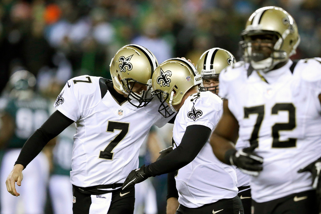 Description of . New Orleans Saints' Luke McCown (7) celebrates with Shayne Graham (3) after Graham's field goal during the first half of an NFL wild-card playoff football game against Philadelphia Eagles, Saturday, Jan. 4, 2014, in Philadelphia. (AP Photo/Julio Cortez)