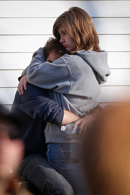 Description of . A couple embrace each other near Sandy Hook Elementary School, where a gunman opened fire on school children and staff in Newtown, Connecticut on December 14, 2012. A heavily armed gunman opened fire on school children and staff at a Connecticut elementary school on Friday, killing at least 26 people, including 18 children, in the latest in a series of shooting rampages that have tormented the United States this year.     REUTERS/Adrees Latif