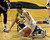 Colorado Buffaloes forward Arielle Roberson (32) falls to the court after colliding with California Golden Bears guard Layshia Clarendon (23) during the second half Sunday, January 6, 2013 at Coors Events Center. John Leyba, The Denver Post