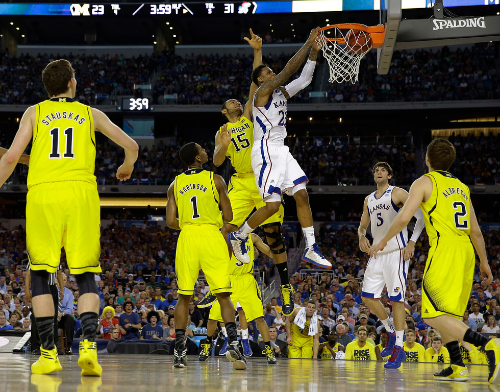 Description of . Kansas\' Ben McLemore dunks during the first half of a regional semifinal game against Michigan in the NCAA college basketball tournament, Friday, March 29, 2013, in Arlington, Texas. (AP Photo/David J. Phillip)