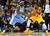Cleveland Cavaliers Kyrie Irving is defended by Denver Nuggets Ty Lawson (L) during the second quarter of their NBA basketball game in Cleveland, February 9, 2013.   REUTERS/Aaron Josefczyk