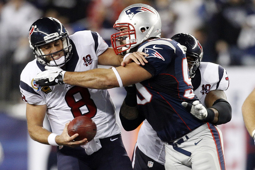 Description of . Houston Texans quarterback Matt Schaub (8) is sacked by New England Patriots defensive end Rob Ninkovich (50) during the first quarter of an NFL football game in Foxborough, Mass., Monday, Dec. 10, 2012. (AP Photo/Stephan Savoia)
