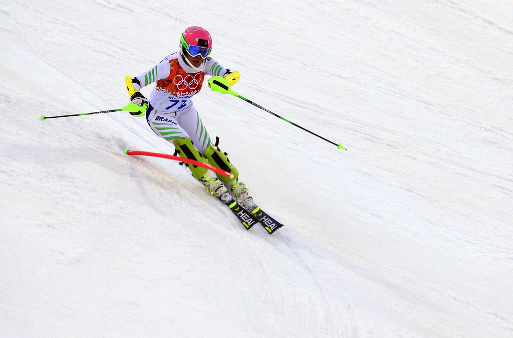Description of . Brazil's Maya Harrisson competes during the Women's Alpine Skiing Slalom Run 1 at the Rosa Khutor Alpine Center during the Sochi Winter Olympics on February 21, 2014.  AFP PHOTO / ALEXANDER  KLEIN/AFP/Getty Images