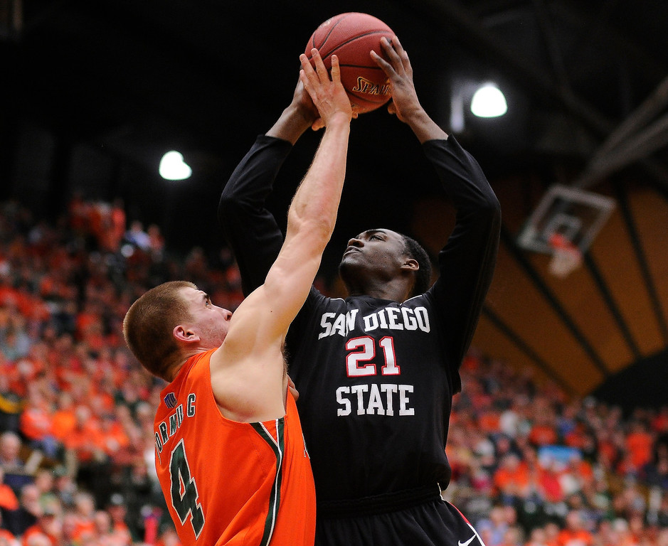 Description of . FT. COLLINS, CO. - FEBRUARY 13: Pierce Hornung (4) of the Colorado State Rams went for a block on Jamaal Franklin (21) of the San Diego State Aztecs in the first half. Colorado State hosted San Diego State February 13, 2013 at Moby Arena in Fort Collins. (Photo By Karl Gehring/The Denver Post)