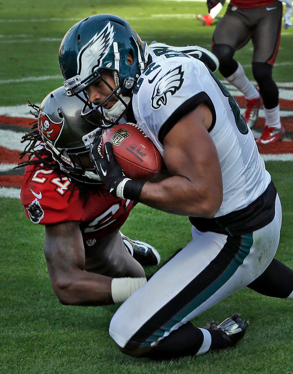Description of . Philadelphia Eagles tight end Clay Harbor (82) pulls in a touchdown in front of Tampa Bay Buccaneers strong safety Mark Barron (24) during the fourth quarter of an NFL football game Sunday, Dec. 9, 2012, in Tampa, Fla. The Eagles won the game 23-21.(AP Photo/Chris O\'Meara)