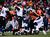 Baltimore Ravens quarterback Joe Flacco (5) makes a pass as Denver Broncos defensive tackle Mitch Unrein (96) moves in for a tackle in the second quarter. The Denver Broncos vs Baltimore Ravens AFC Divisional playoff game at Sports Authority Field Saturday January 12, 2013. (Photo by AAron  Ontiveroz,/The Denver Post)