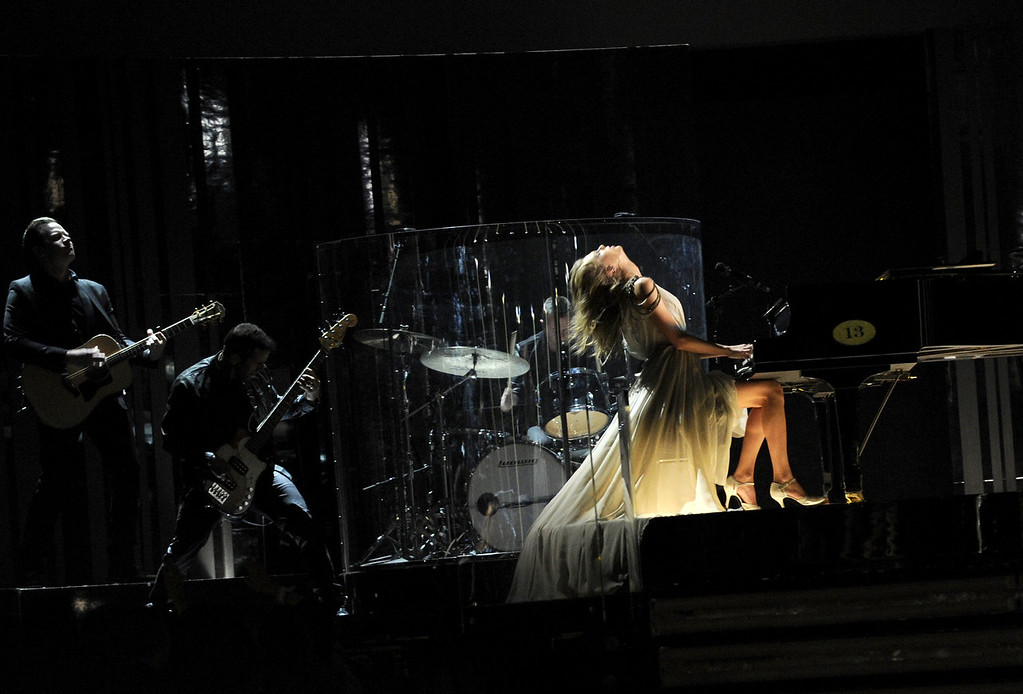 Description of . Musician Taylor Swift performs onstage during the 56th GRAMMY Awards at Staples Center on January 26, 2014 in Los Angeles, California.  (Photo by Kevork Djansezian/Getty Images)
