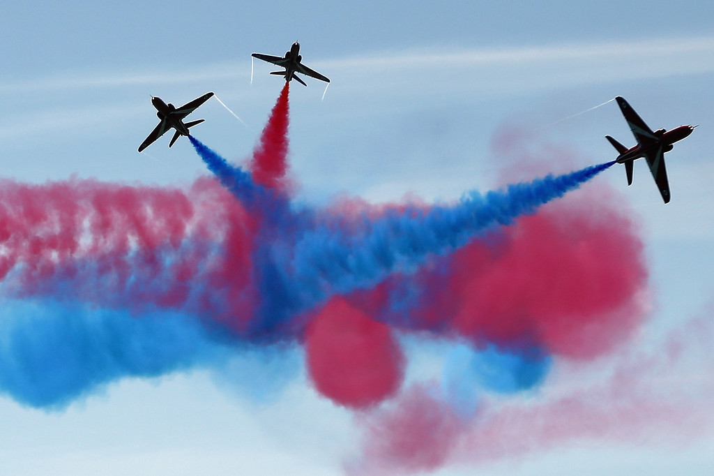 Description of . The Red Arrows display team perform over Southsea Common at the end of a commemoration service of the D-Day landings on June 5, 2014 in Portsmouth, England.   (Photo by Dan Kitwood/Getty Images)