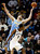 Denver Nuggets center Kosta Koufos (41) reaches for a loose ball over Memphis Grizzlies guard Tony Allen (9) in the second half of an NBA basketball game on Saturday, Dec. 29, 2012, in Memphis, Tenn. The Grizzlies won 81-72. (AP Photo/Lance Murphey)