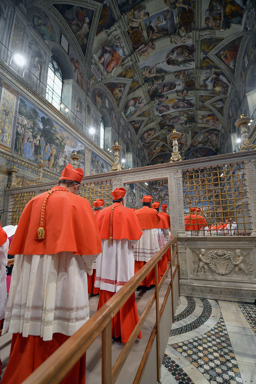 "Description of . This handout picture released by the Press office shows cardinals arriving at the Sistine Chapel before the start of the conclave at the Vatican on March 12, 2013.   �AFP PHOTO/OSSERVATORE ROMANO""-/AFP/Getty Images"