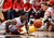 New Mexico's Jamal Fenton, left, tries to recover a loose ball as teammate Cameron Bairstow watches during he first half of an NCAA college basketball game against Wyoming in Albuquerque, N.M., Saturday, March 2, 2013. (AP Photo/ Craig Fritz)