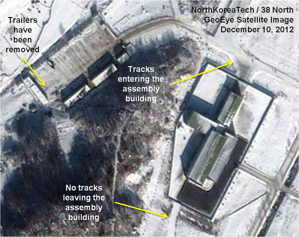 . This Monday Dec. 10, 2012 satellite image provided by GeoEye and annotated by 38 North, shows recent activity at the Sohae rocket launching facility in Cholsan County, North Pyongan Province, North Korea. An analysis written for 38 North, the website of the U.S.-Korean Institute at John Hopkins Advanced International Studies, predicted it\'s likely to take until Dec. 12-13 to remove the Unha-3 rocket and more than a week to repair it, meaning a launch is unlikely before Dec. 21-22. (AP Photo/GeoEye, 38 North, North Korea Tech)