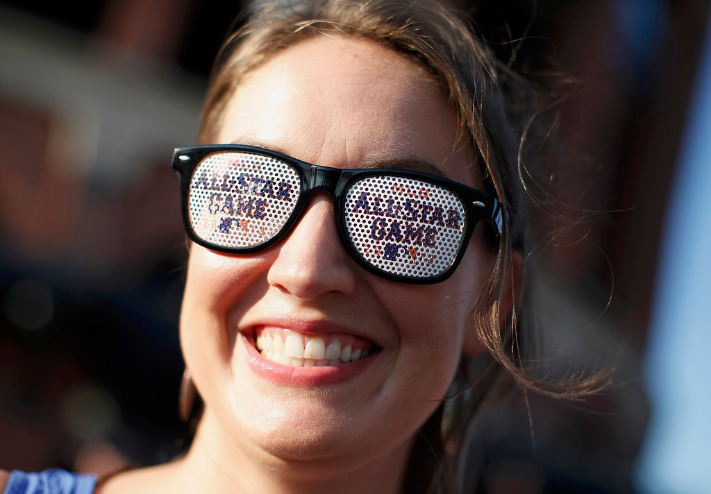 Description of . Baseball fan Erin McCutchen wears All-Star glasses as she arrives for Major League Baseball's All-Star Game in New York, July 16 2013. REUTERS/Mike Segar