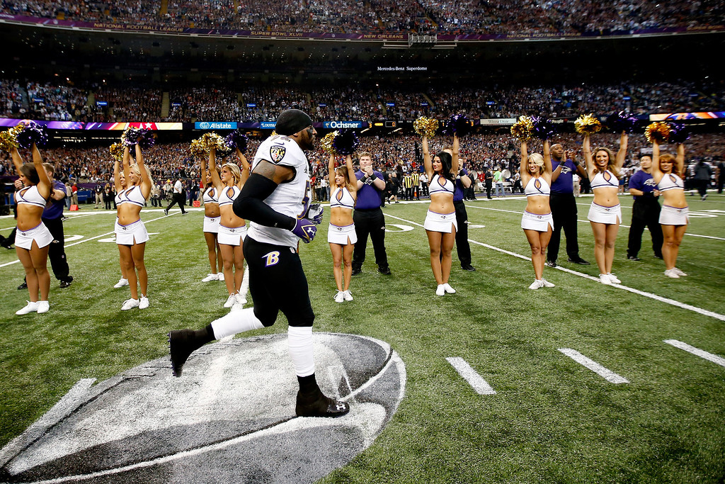 Description of . Ray Lewis #52 of the Baltimore Ravens runs onto the field prior to Super Bowl XLVII against the San Francisco 49ers at the Mercedes-Benz Superdome on February 3, 2013 in New Orleans, Louisiana.  (Photo by Chris Graythen/Getty Images)