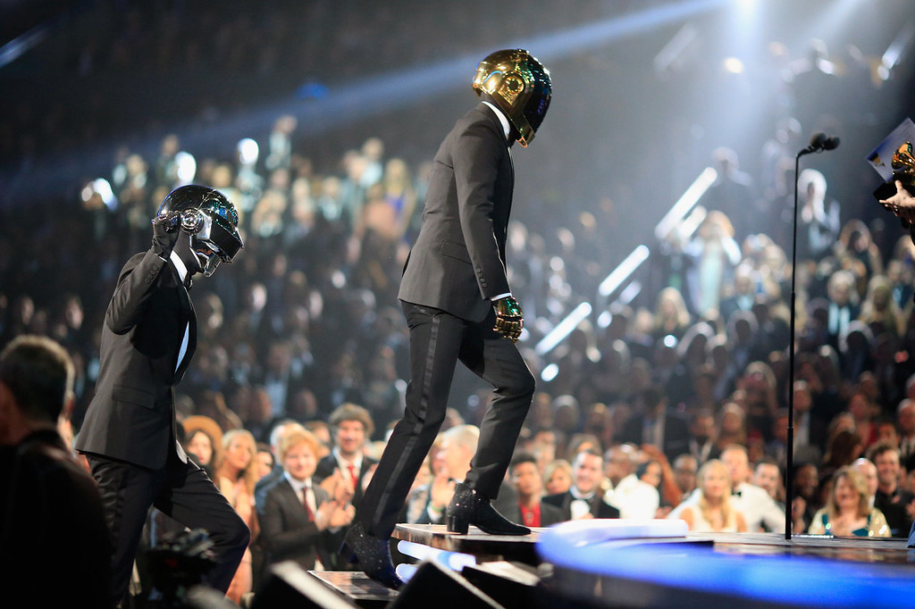 Description of . Recording artists Guy-Manuel de Homem-Christo (L) and Thomas Bangalter accepting their award for Best Pop Duo/Group Performance during the 56th GRAMMY Awards at Staples Center on January 26, 2014 in Los Angeles, California.  (Photo by Christopher Polk/Getty Images for NARAS)