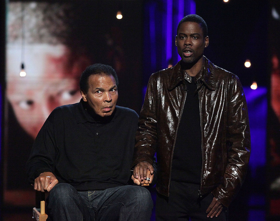 Description of . In this handout photo provided by MTV, Boxer Muhammad Ali and comedian Chris Rock perform during the Hope For Haiti Now: A Global Benefit For Earthquake Relief at CBS Television City January 22, 2010 in Los Angeles, Californa.  (Photo by Handout/MTV Hope for Haiti Now via Getty Images)