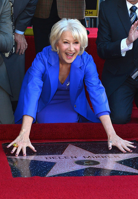Description of . Actress Helen Mirren,  Honored On The Hollywood Walk Of Fame with her own star on January 3, 2013 in Hollywood, California.  (Photo by Frazer Harrison/Getty Images)
