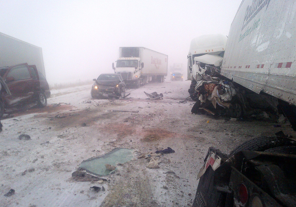 Description of . This photo provided by the Iowa State Patrol shows the scene of a 25-vehicle pileup that killed three people Thursday, Dec. 20, 2012 north of Des Moines, Iowa.  Authorities said drivers were blinded by blowing snow and didnít see vehicles that had slowed or stopped on Interstate 80 about 60 miles north of Des Moines. A chain reaction of crashes involving semitrailers and passenger cars closed down a section of the highway. (AP Photo/Iowa State Patrol)