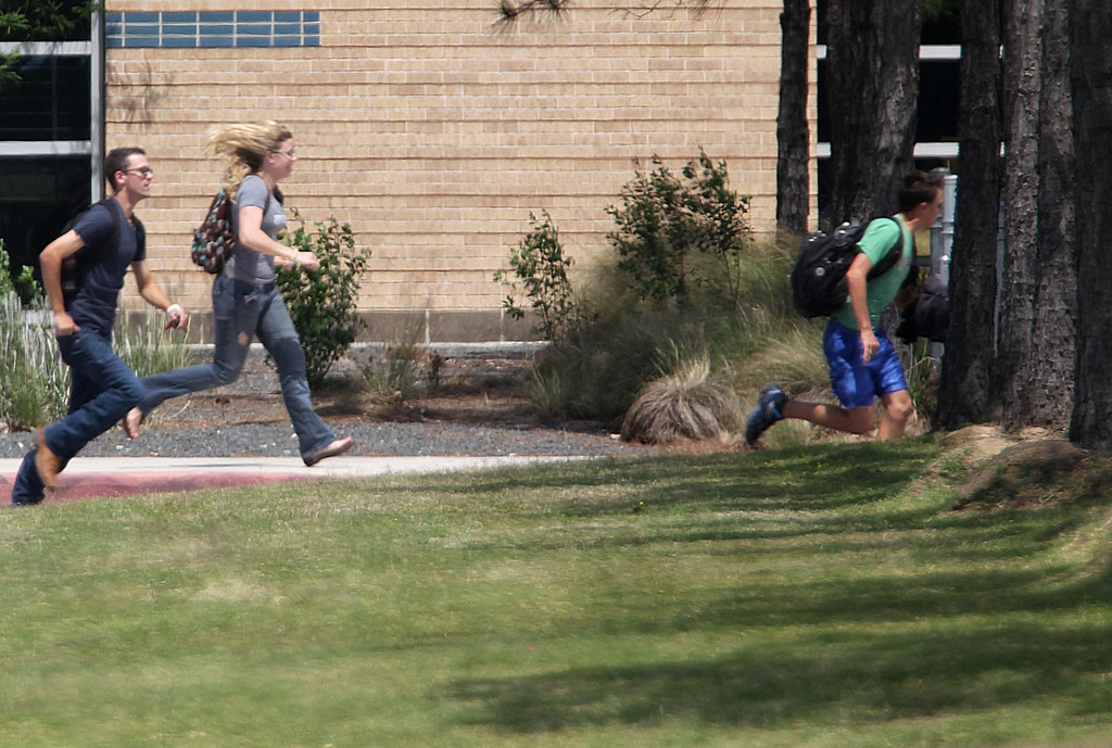 Description of . Students run from the Lone Star College's Cy-Fair campus in Cypress, Texas, where a student went on a building-to-building stabbing attack Tuesday, April 9, 2013. (AP Photo/Houston Chronicle, James Nielsen) MANDATORY CREDIT