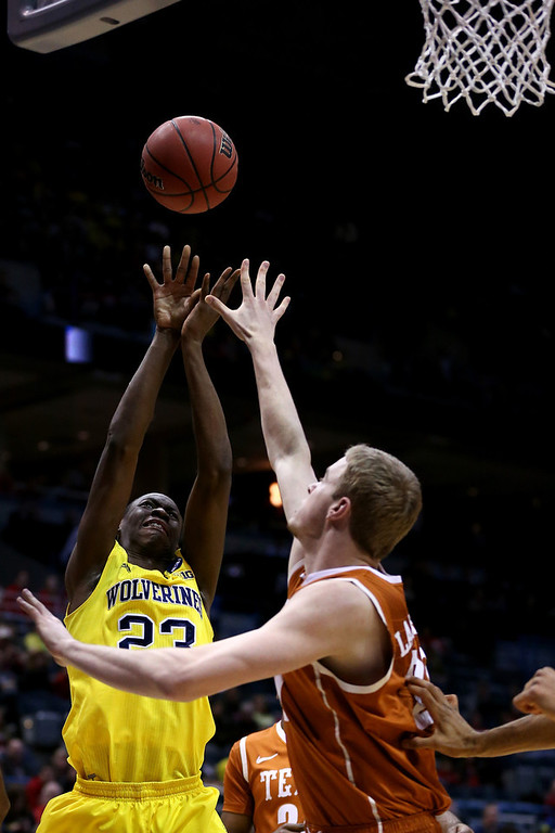 Description of . Caris LeVert #23 of the Michigan Wolverines shoots the ball against the Texas Longhorns during the third round of the 2014 NCAA Men's Basketball Tournament at BMO Harris Bradley Center on March 22, 2014 in Milwaukee, Wisconsin.  (Photo by Jonathan Daniel/Getty Images)