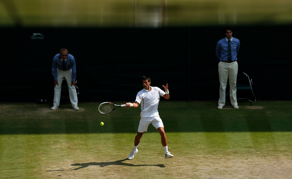 Description of . Novak Djokovic of Serbia plays a return to Juan Martin Del Potro of Argentina during their Men\'s singles semifinal match at the All England Lawn Tennis Championships in Wimbledon, London, Friday, July 5, 2013. (AP Photo/Jonathan Brady, Pool)