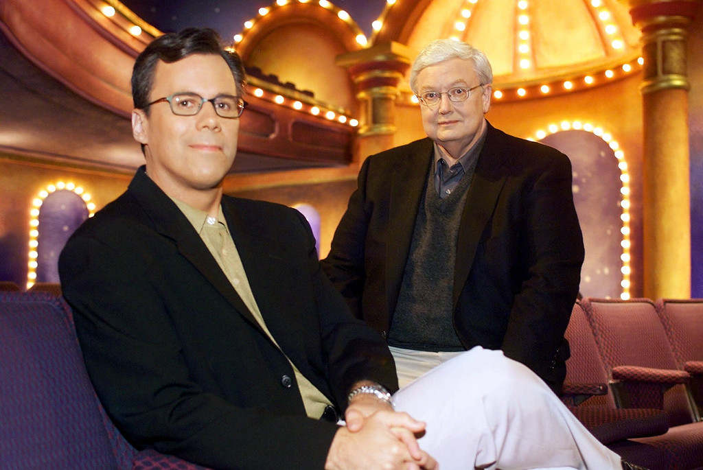 "Description of . Chicago Sun-Times columnist Richard Roeper, left, sits with Sun-Times film critic Roger Ebert on the set of the newly named ""Ebert & Roeper and The Movies\"" Wednesday, July 12, 2000, in Chicago. (AP Photo/Fred Jewell)"