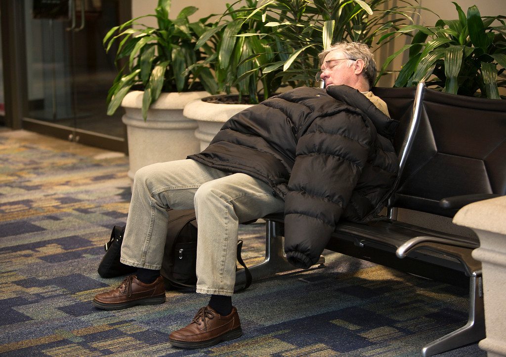 Description of . Mike Picchietti, of Florida, takes a nap at Norfolk International Airport after learning that his flight had been canceled Wednesday, Jan. 29, 2014 in Norfolk, Va. Most flights in and out of the airport were delayed or canceled. The coast of Virginia was blanketed in up to 10 inches of snow Wednesday, with many workers in the heavily populated Hampton Roads region being told to stay home rather than travel to work in dangerous conditions. (AP Photo/The Virginian-Pilot, The' N. Pham)