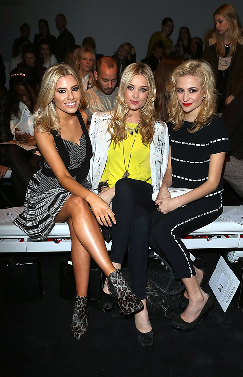 Description of . LONDON, ENGLAND - FEBRUARY 16: (L-R) Mollie King, Laura Whitmore and Pixie Lott attend the David Koma show during London Fashion Week Fall/Winter 2013/14 at Somerset House on February 16, 2013 in London, England.  (Photo by Tim Whitby/Getty Images)