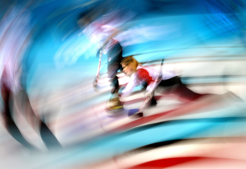 Description of . Jennifer Jones of Canada in action during the Women's Gold medal match between Sweden and Canada in the Curling competition in the Ice Cube Curling Center at the Sochi 2014 Olympic Games, Sochi, Russia, 20 February 2014.  EPA/TATYANA ZENKOVICH