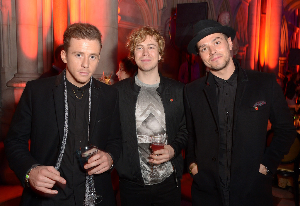 Description of . Danny Jones from McFly and James Bourne and Matt Willis from Busted attend the 'The Hunger Games: Catching Fire' Premiere After-Party, on Monday Nov. 11, 2013 in the Royal Court of Justice, London. 'Catching Fire' is the second installment in 'The Hunger Games' trilogy. (Photo by Jon Furniss/Invision/AP)