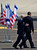 US President Barack Obama, right, and Israel's President Shimon Peres walk together at the end of welcoming ceremony upon Obama's arrival at Ben Gurion airport near Tel Aviv, Israel, Wednesday, March 20, 2013. (AP Photo/Ariel Schalit)