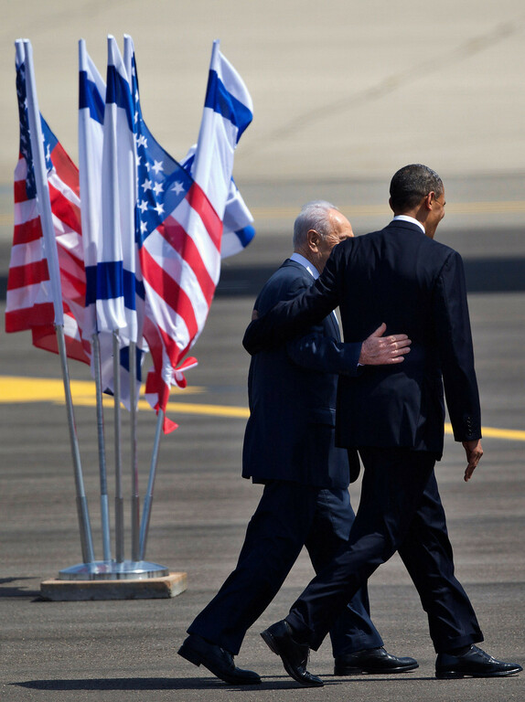 Description of . US President Barack Obama, right, and Israel's President Shimon Peres walk together at the end of welcoming ceremony upon Obama's arrival at Ben Gurion airport near Tel Aviv, Israel, Wednesday, March 20, 2013. (AP Photo/Ariel Schalit)