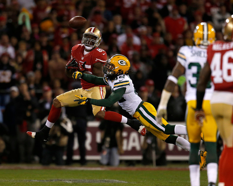Description of . The Green Bay Packers' Morgan Burnett (42) breaks up a pass intended for the San Francisco 49ers' Vernon Davis (85) in the second quarter in the NFC Divisional Playoff on Saturday, January 12, 2013, at Candlestick Park in San Francisco, California. (Nhat V. Meyer/San Jose Mercury News)
