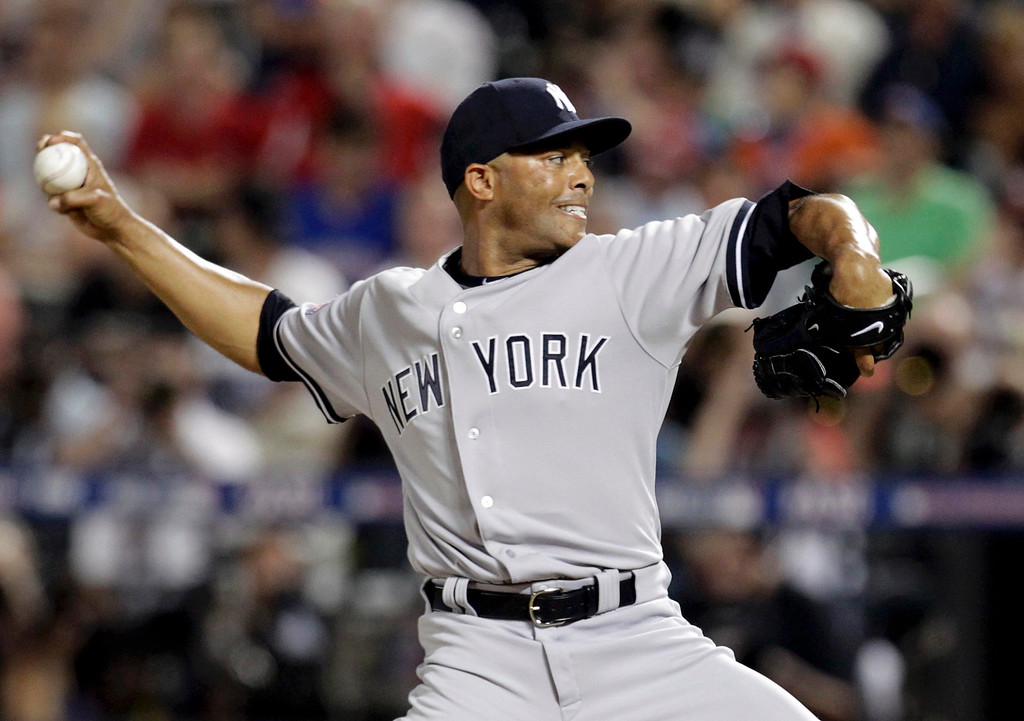 Description of . American League pitcher Mariano Rivera of New York Yankees throws in the eighth inning against the National League during Major League Baseball's All-Star Game in New York, July 16, 2013.  REUTERS/Shannon Stapleton