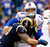 Buffalo Bills quarterback Ryan Fitzpatrick, right, is hit by St. Louis Rams defensive end Chris Long during the first half of an NFL football game, Sunday, Dec. 9, 2012, in Orchard Park, N.Y. (AP Photo/Bill Wippert)