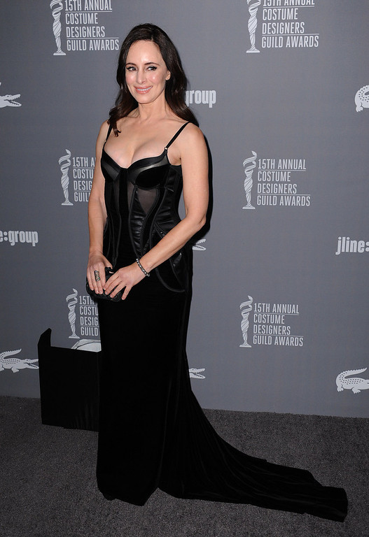 Description of . Madeleine Stowe arrives at the 15th Annual Costume Designers Guild Awards at The Beverly Hilton Hotel on Tuesday, Feb. 19, 2013 in Beverly Hills. (Photo by Jordan Strauss/Invision/AP)